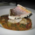 Grilled red snapper with lobster, bacon and porcini stew
