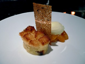 Panettone bread pudding with muscat-glazed apricots and olive oil ice cream