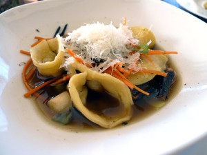 "Carleton Farms pork tortellini with charred ramps and ""molla brodo\"""
