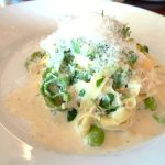 Paglia e fieno: Spinach and egg fettucine with tuna cream sauce, garlic, pea shoots, parsley and fava beans
