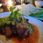 Muu paa kham waan: boar collar meat with chilled mustard greens