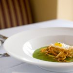 Spring garlic soup with potato nest, chicken and quail egg