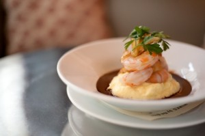 Frank\'s Oyster House: Lobster-poached prawns on cauliflower-potato puree with gingered veal demi-glace