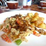 "Crawfish, tasso, and ""holy trinity"" scramble with black-pepper tasso gravy"
