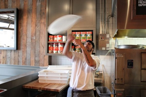 Chef Keiji demonstrates his pizza dough tossing and twirling skills.