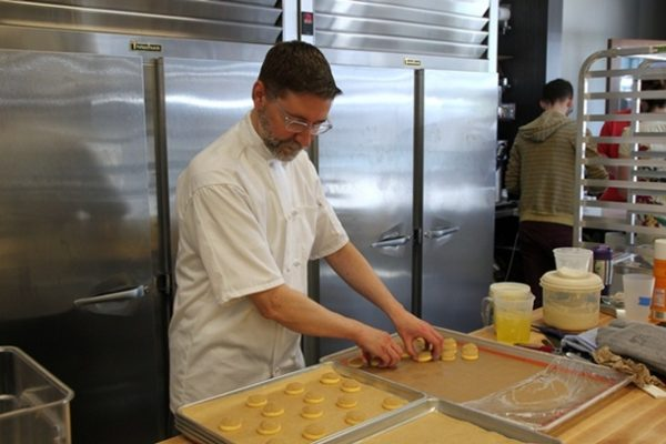 Chef Neil Robertson prepares cream puffs, which are filled to order.