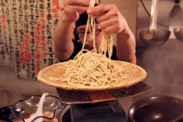 One of the chefs measures out a noodle order on the scale. If you order regular ramen (soup), you'll get 200 grams of noodles. But if you want tsukemen (noodles that you dip in broth that's served lukewarm on the side), the ticket machine will show options of 300 or 400 grams for the same price. Choose what you like, though note that women may be asked if they prefer a more dainty 200 grams. And if that's that not enough noodles, heavyweight ramen eaters can order more: large (+100 grams) or extra-large (+200 grams).