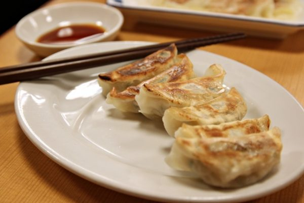Gyoza is probably the most popular side dish at a ramen restaurant. They're crispy on the outside, juicy on the inside, and you dip them in soy sauce.