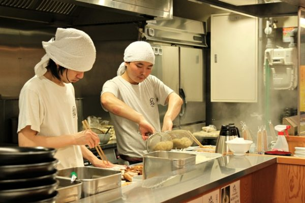 Chefs preparing the food at Hirugao. The workers are diligent and proud of their creations. It's hot and hectic in the kitchen, but they march on. Note the double-fisted approach of the chef on the right, pouring two noodle baskets at the same time.