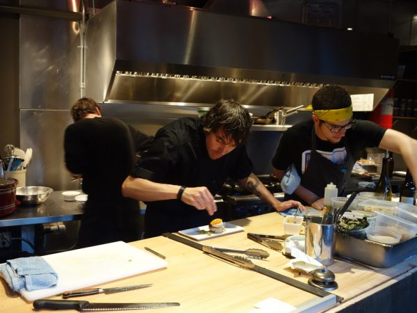 Chef Derek Ronspies, plating up a dish