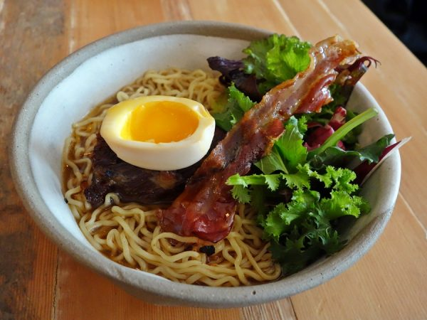 Western-style ramen with beef brisket, mirin-glazed bacon, and mixed greens at Burdock & Co.