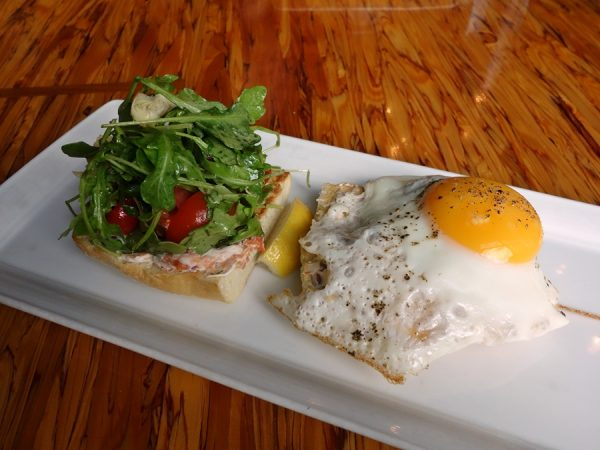 Saumon fume (open-faced ciabatta sandwich with fried egg, smoked salmon, caper cream cheese, sliced avocado, arugula, peppadew and artichoke salad) at Cafe Medina