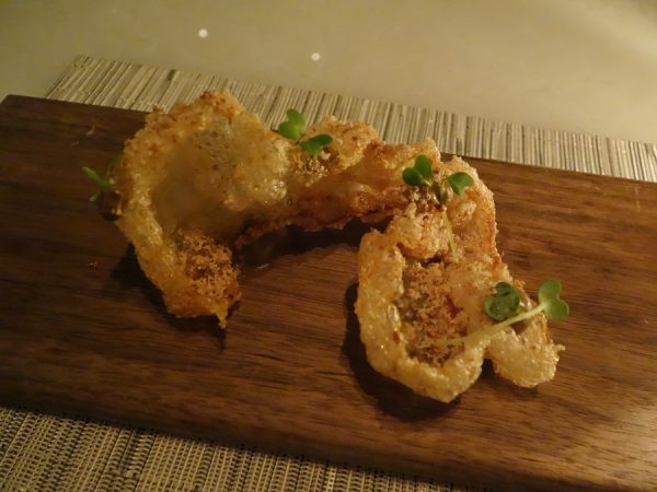Puffed beef tendon (chicharron) with foie gras, gewurztraminer, and black truffle at Hawksworth