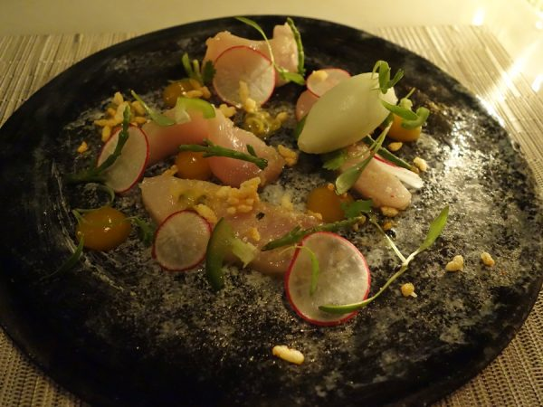 Hamachi sashimi with passion fruit, jalapeno, coconut, and white soy at Hawksworth