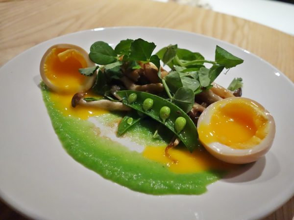 Mushrooms with snap peas, egg, and soy yuzu brown butter at PiDGiN
