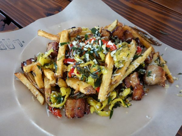 "You can get ""regular"" fries at Lardo, but for a few bucks more, upgrade to ""Dirty Fries"" with pork scraps, marinated peppers, fried herbs and parmesan"