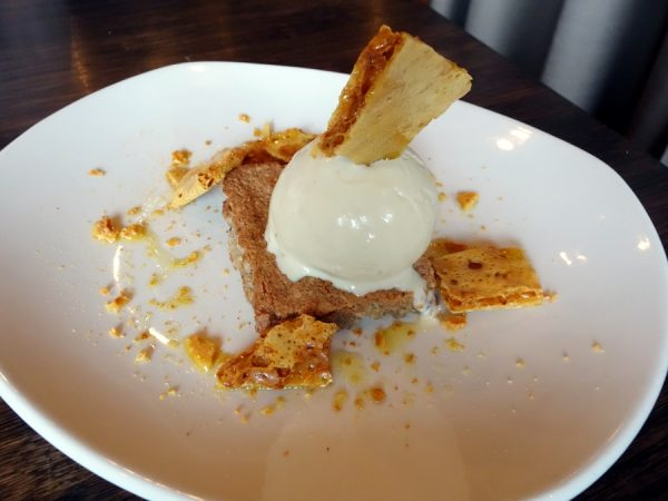 Ox: Warm Hazelnut Brown Butter Torte with Honey Chamomile Ice Cream and Honeycomb Candy