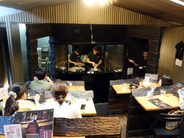 The theater-like seating at Mengekijo Genei, where you watch the chef at work