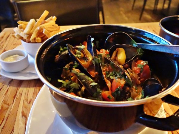 Chambar's moule frites congolaise: mussels, tomato coconut cream, smoked chili & lime, and cilantro