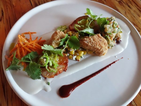 Chambar's duo de thon: fried & ceviche albacore tuna, charred corn salsa, black aji, and coconut creme fraiche