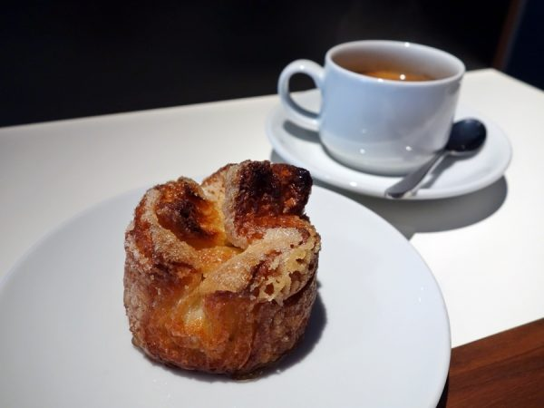 Patrice Patissier's kouign amann is crunchy with good caramelization. Café allongé with it hits the spot.