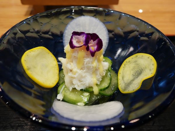 Dungeness crab salad with miso mustard dressing, along with zucchini, daikon, and cucumbers sunonomo-style (wakame and somen below)