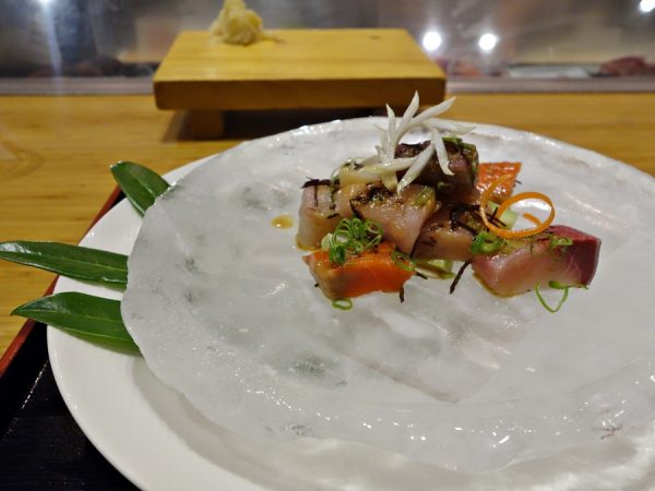 Sashimi starter with Tojo's signature sauce (citrusy miso with some jalapeno, soy sauce, and sesame seeds)