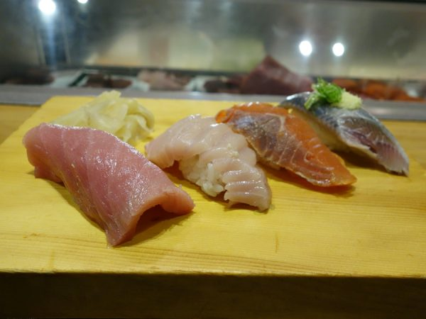 Some sushi: two types of tuna toro, smoked salmon, and sardine