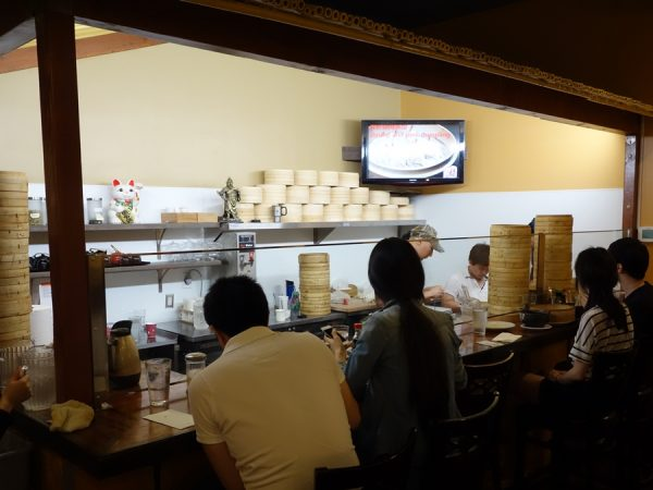 Seating at the counter, watching the dumpling-making