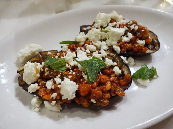 Oak-grilled eggplant with feta cheese, romesco sauce, and mint