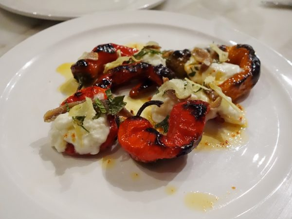 Oak-grilled Jimmy Nardello peppers with anchovy, burrata, crispy garlic, and mint