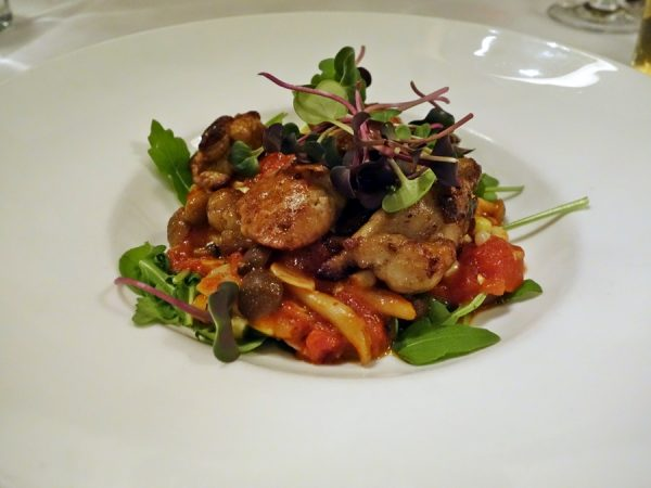 Sauteed sweetbreads with foraged mushrooms, sweet corn, arugula, and tomato pan sauce at Colt & Gray