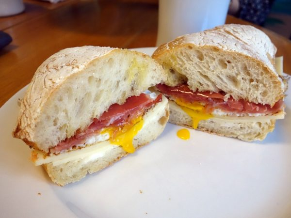 The Park at at Curtis Park Deli: runny egg, prosciutto, olive oil, house butter, and white cheddar