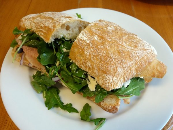 The Fish at at Curtis Park Deli: smoked trout, house aioli, capers, olive oil, onions, arugula, lemon juice, and blue cheese