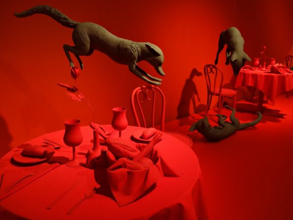 """Fox Games"" in a red restaurant at the Denver Art Museum"