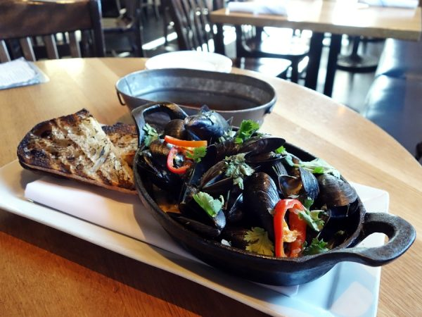 Thai-style mussels with Upslope White Thai IPA, kaffir lime and lemongrass infused coconut milk, Thai basil, cilantro, Fresno chilies, shallots, and French country bread at Euclid Hall