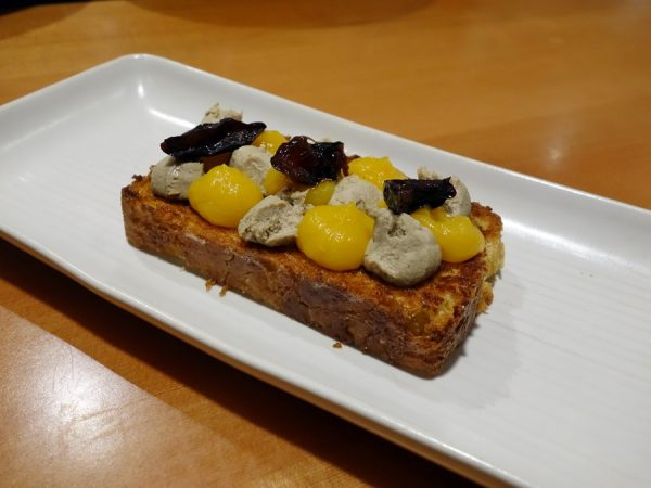 Chicken liver mousse on toasted brioche with winter squash and Italian plum at Lower48 Kitchen