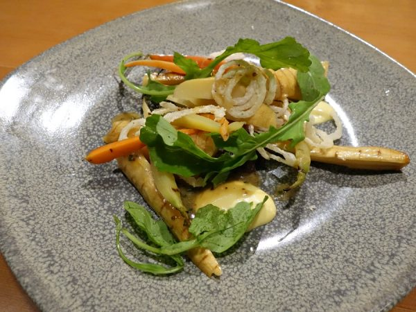 Pressed parsnips and carrots with bearnaise, mustard, crispy shallots, and brown butter vinaigrette at Lower48 Kitchen