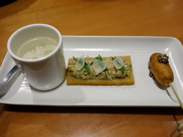 Left to right: (1) Grilled and chilled cucumber soup with rosemary oil, (2) toasted hashbrowns with PEI mussels, pickled pearl onions, and celery, and (3) corn dog with house-made mustard at Lower48 Kitchen