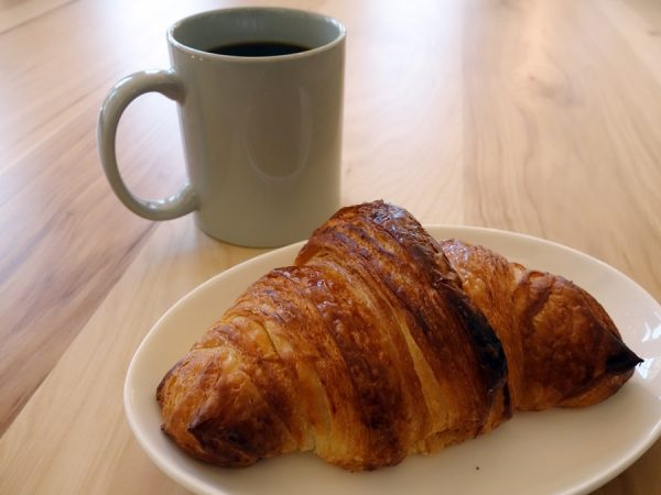 Croissant and coffee at Mercantile Dining & Provision