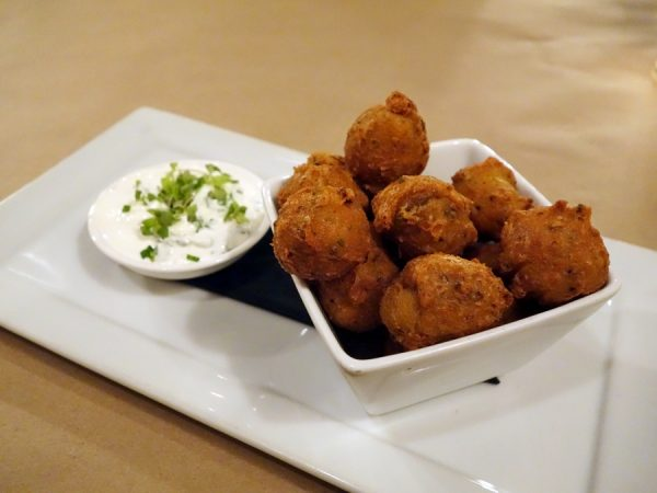 Spice Kitchen + Bar's mushroom beignets (dusted with porcini powder) with honey goat cheese crème fraîche