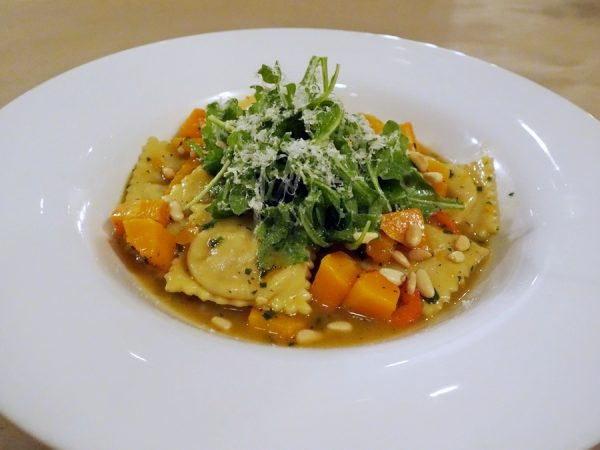 Spice's rabbit ravioli with chanterelles, goat cheese, squash, pine nuts, shishito peppers, and herbs