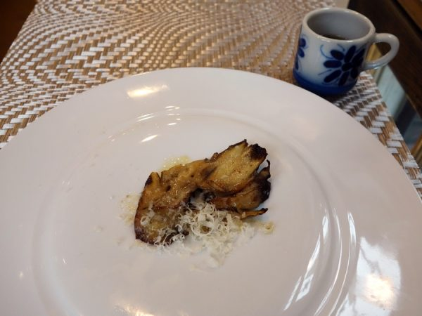 An experiment ahead of Ferran Adrià's visit: spit-roasted and seared maitake garnished with trentigrana, plus dashi made from house-cured fish sausage and dried wild foraged maitake mushrooms