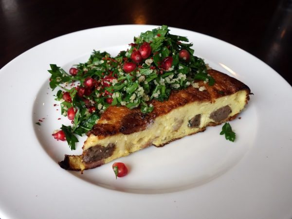 Bacon, lamb sausage, and onion frittata at Cafe Castagna (with a Christmas-like topping of pomegranates and parsley)