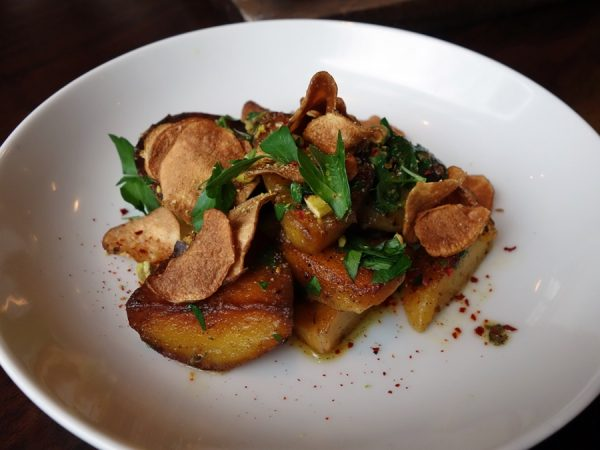 Schmaltz-roasted potato, sunchoke, quince, and creme fraiche