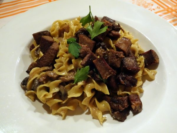 Kachka's stroganoff with beef tongue, egg noodles, mushroom and cognac smetana sauce