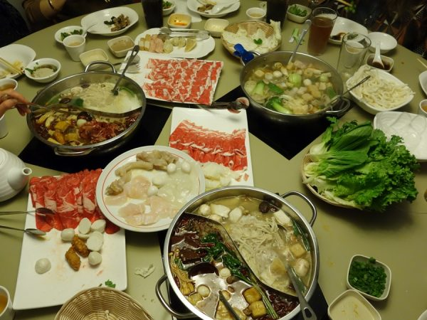 Table full of food at Little Sheep Mongolian Hot Pot
