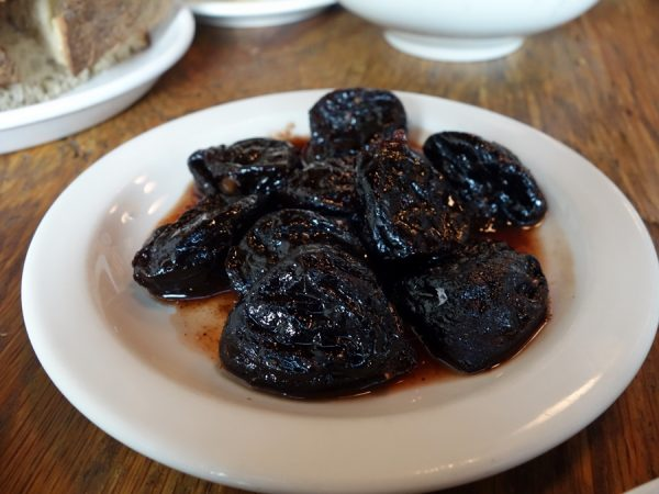 Navarre's walnut-stuffed prunes with pomegranate sauce (rich and delicious)