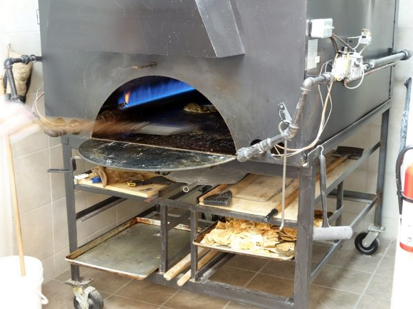 My pita pie in the oven at Pita Hut Bakery