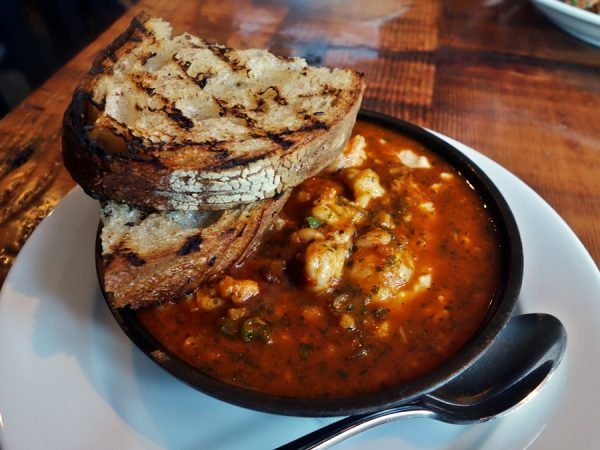 """Shrimp and grits with red gravy (""""wetter"""" than most I've had, but perfect for bread dipping)"""